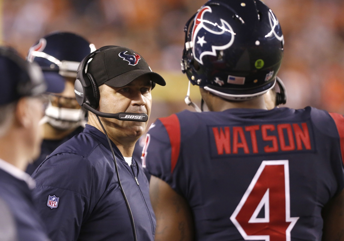 Sep 14, 2017; Cincinnati, OH, USA; Houston Texans head coach Bill O'Brien (left) talks with quarterback Deshaun Watson (4) during the first half against the Cincinnati Bengals at Paul Brown Stadium. Mandatory Credit: David Kohl-USA TODAY Sports