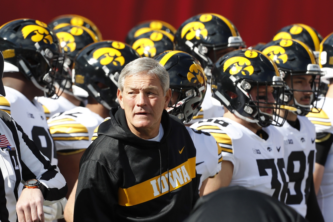 Oct 13, 2018; Bloomington, IN, USA; Iowa Hawkeyes coach Kirk Ferentz waits with his during player introductions before the game against the Indiana Hoosiers at Memorial Stadium . Mandatory Credit: Brian Spurlock-USA TODAY Sports