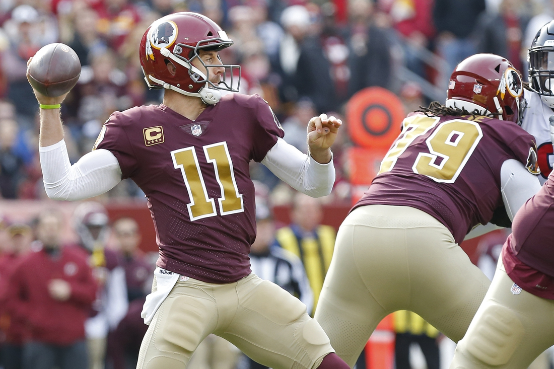 Nov 18, 2018; Landover, MD, USA; Washington Redskins quarterback Alex Smith (11) passes the ball against the Houston Texans in the first quarter at FedEx Field. Mandatory Credit: Geoff Burke-USA TODAY Sports