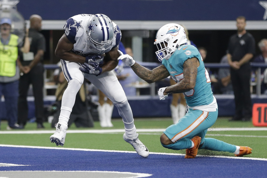 Sep 22, 2019; Arlington, TX, USA; Dallas Cowboys wide receiver Amari Cooper (19) catches a touchdown pass against Miami Dolphins cornerback Xavien Howard (25) in the third quarter at AT&T Stadium. Mandatory Credit: Tim Heitman-USA TODAY Sports