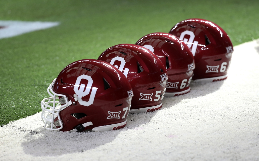 Dec 7, 2019; Arlington, TX, USA; Oklahoma Sooners helmets are lined up before the game against the Baylor Bears in the 2019 Big 12 Championship Game at AT&T Stadium. Mandatory Credit: Kevin Jairaj-USA TODAY Sports