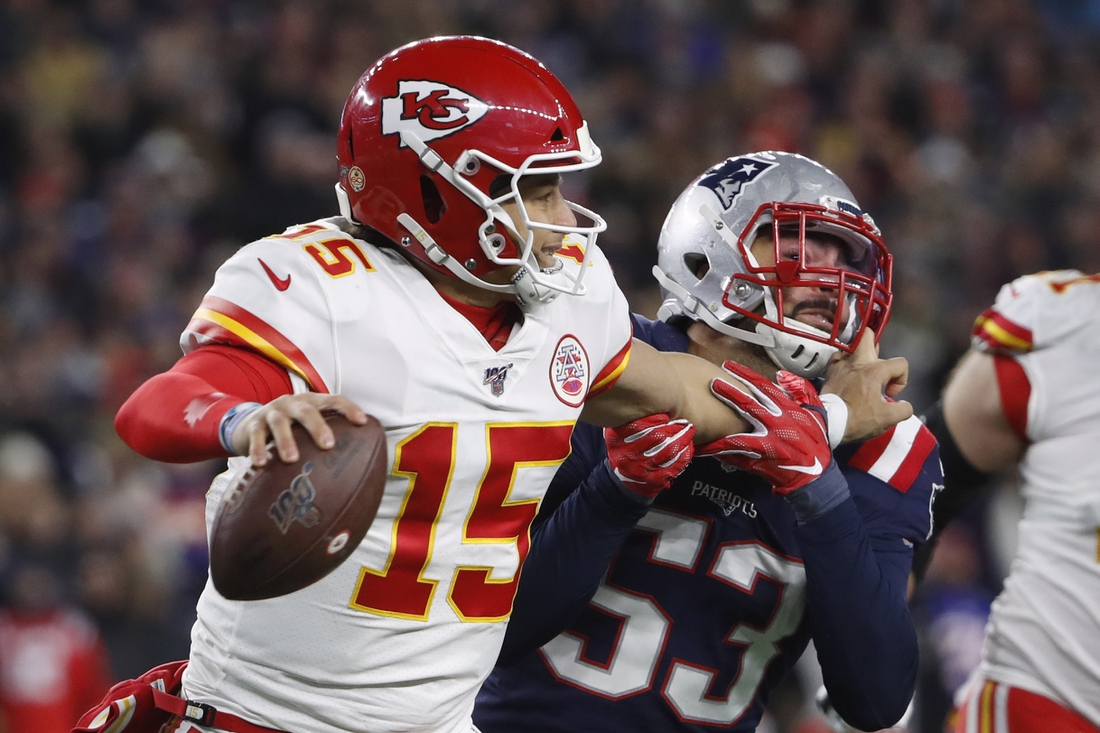 Dec 8, 2019; Foxborough, MA, USA; Kansas City Chiefs quarterback Patrick Mahomes (15) grabs the face mask of New England Patriots middle linebacker Kyle Van Noy (53) while trying to get away resulting in a penalty against Mahomes during the second half at Gillette Stadium. Mandatory Credit: Winslow Townson-USA TODAY Sports