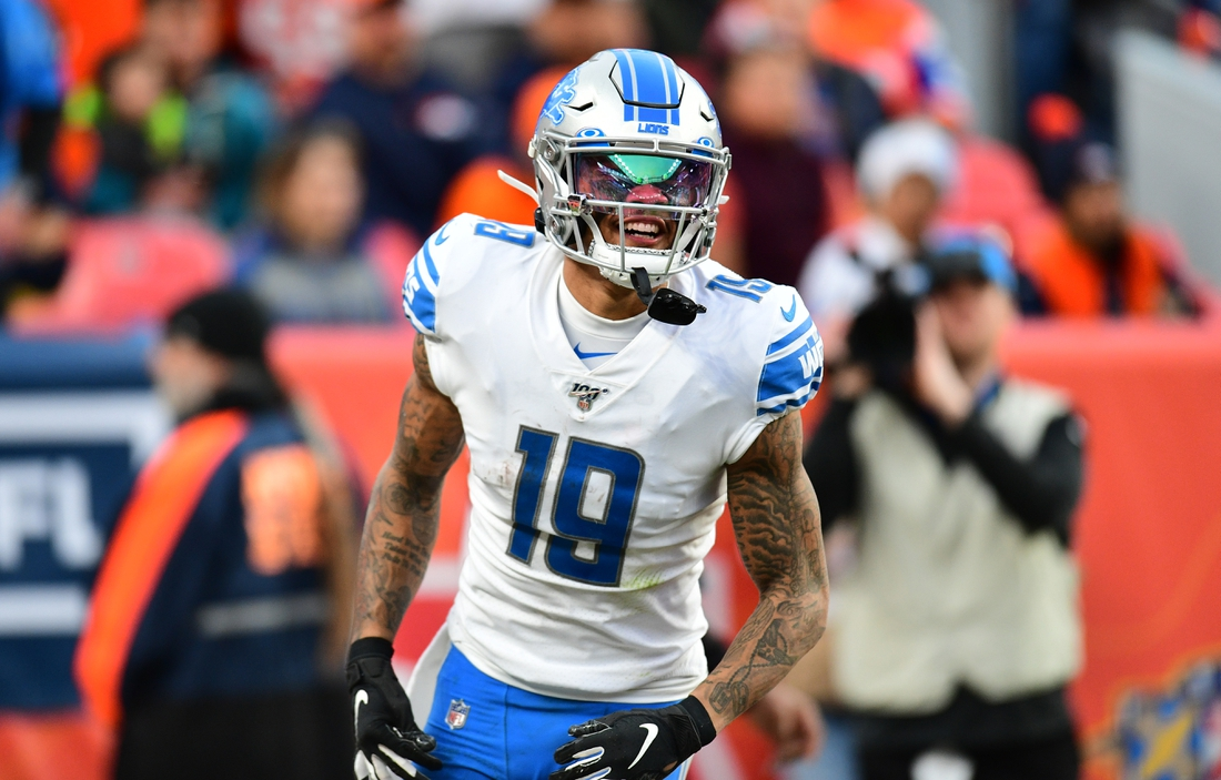 Dec 22, 2019; Denver, Colorado, USA; Detroit Lions wide receiver Kenny Golladay (19) celebrates his touchdown reception in the third quarter against the Denver Broncos at Empower Field at Mile High. Mandatory Credit: Ron Chenoy-USA TODAY Sports