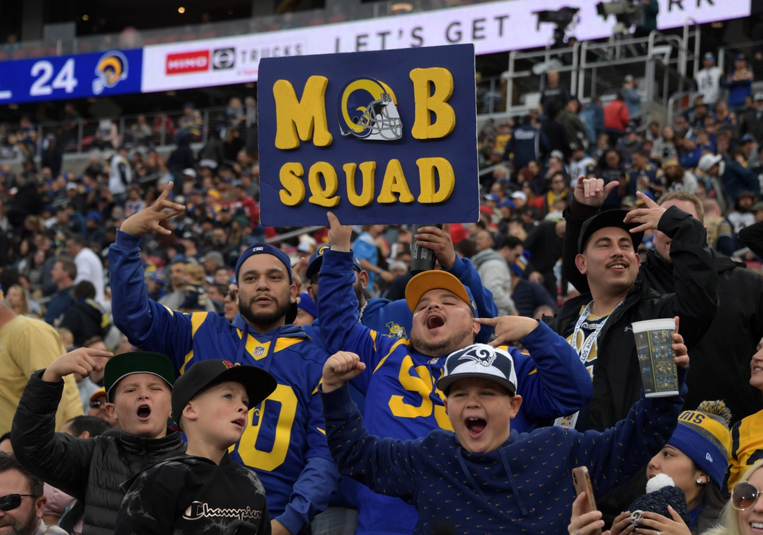 Dec 29, 2019; Los Angeles, California, USA; Los Angeles Rams fans hold Mob Squad sign during the Rams final home game at Los Angeles Memorial Coliseum before moving to SoFi Stadium for the 2020 season. The Rams defeated the Arizona Cardinals 31-24 Mandatory Credit: Kirby Lee-USA TODAY Sports