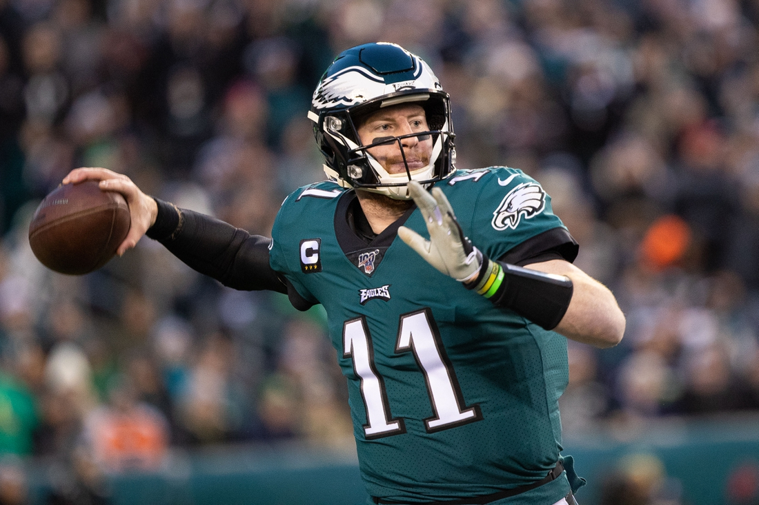 Jan 5, 2020; Philadelphia, Pennsylvania, USA; Philadelphia Eagles quarterback Carson Wentz (11) passes against the Seattle Seahawks during the first quarter in a NFC Wild Card playoff football game at Lincoln Financial Field. Mandatory Credit: Bill Streicher-USA TODAY Sports