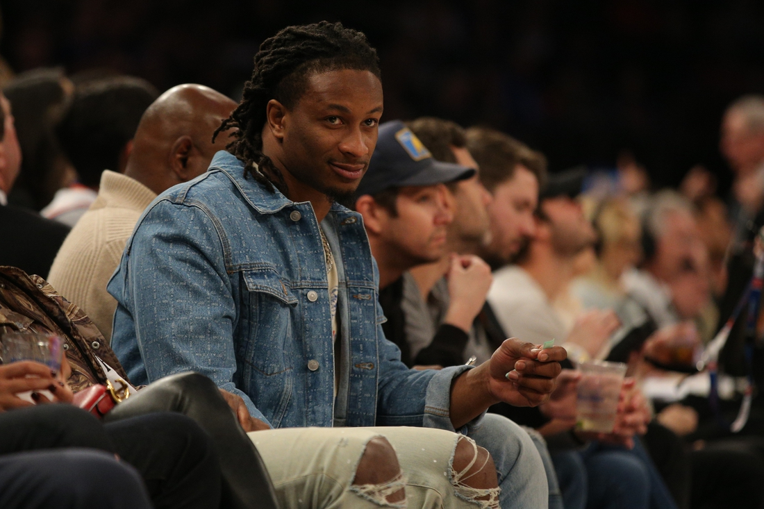 Jan 10, 2020; New York, New York, USA; NFL running back Todd Gurley watches the New York Knicks play the New Orleans Pelicans during the third quarter at Madison Square Garden. Mandatory Credit: Brad Penner-USA TODAY Sports