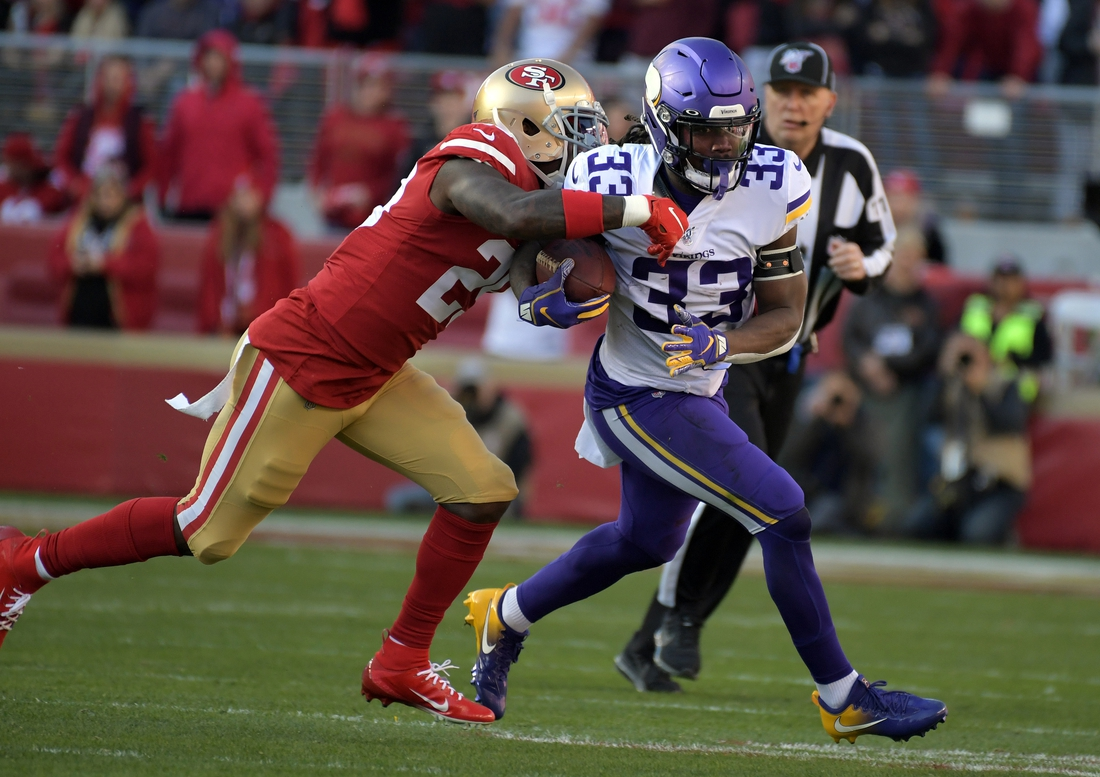 Jan 11, 2020; Santa Clara, California, USA; Minnesota Vikings running back Dalvin Cook (33) runs the ball against San Francisco 49ers cornerback Ahkello Witherspoon (23) during the first half in the NFC Divisional Round playoff football game at Levi's Stadium. Mandatory Credit: Kirby Lee-USA TODAY Sports