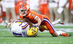 Jan 13, 2020; New Orleans, Louisiana, USA; Clemson Tigers cornerback cornerback A.J. Terrell (8) tackles LSU Tigers wide receiver Ja'Marr Chase (1) in the College Football Playoff national championship game at Mercedes-Benz Superdome. Mandatory Credit: Mark J. Rebilas-USA TODAY Sports