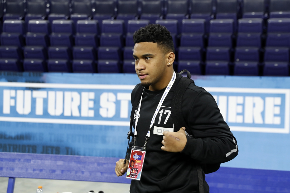 Feb 27, 2020; Indianapolis, Indiana, USA; Alabama quarterback Tua Tagovailoa (QB17) watches from the sidelines during the 2020 NFL Combine at Lucas Oil Stadium. Mandatory Credit: Brian Spurlock-USA TODAY Sports