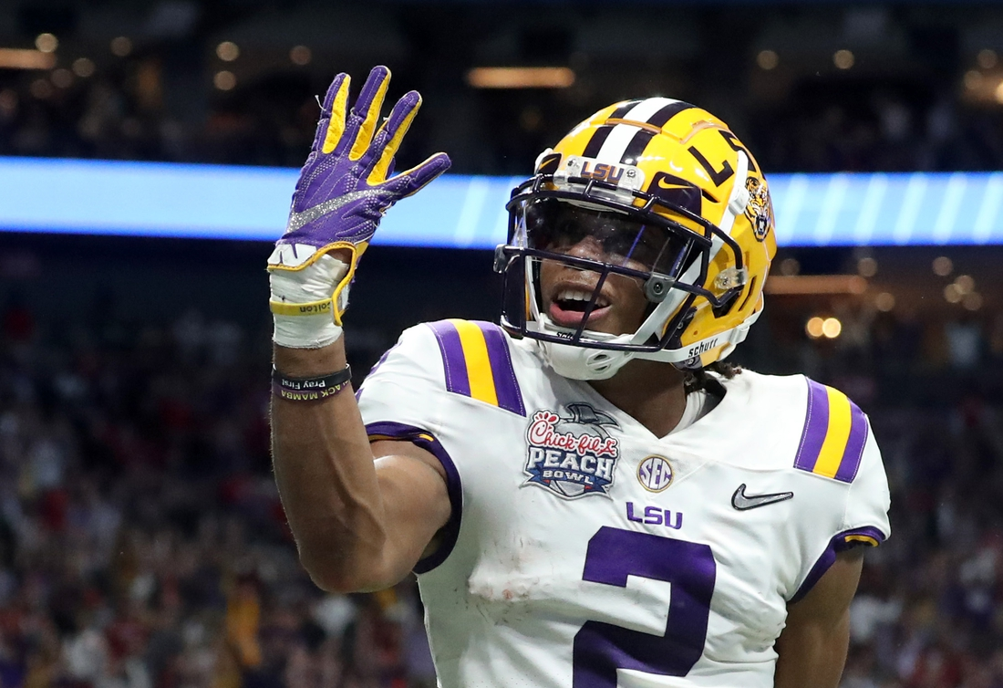 Dec 28, 2019; Atlanta, Georgia, USA; LSU Tigers wide receiver Justin Jefferson (2) reacts after his fourth touchdown during the second quarter of the 2019 Peach Bowl college football playoff semifinal game against the Oklahoma Sooners at Mercedes-Benz Stadium. Mandatory Credit: Jason Getz-USA TODAY Sports