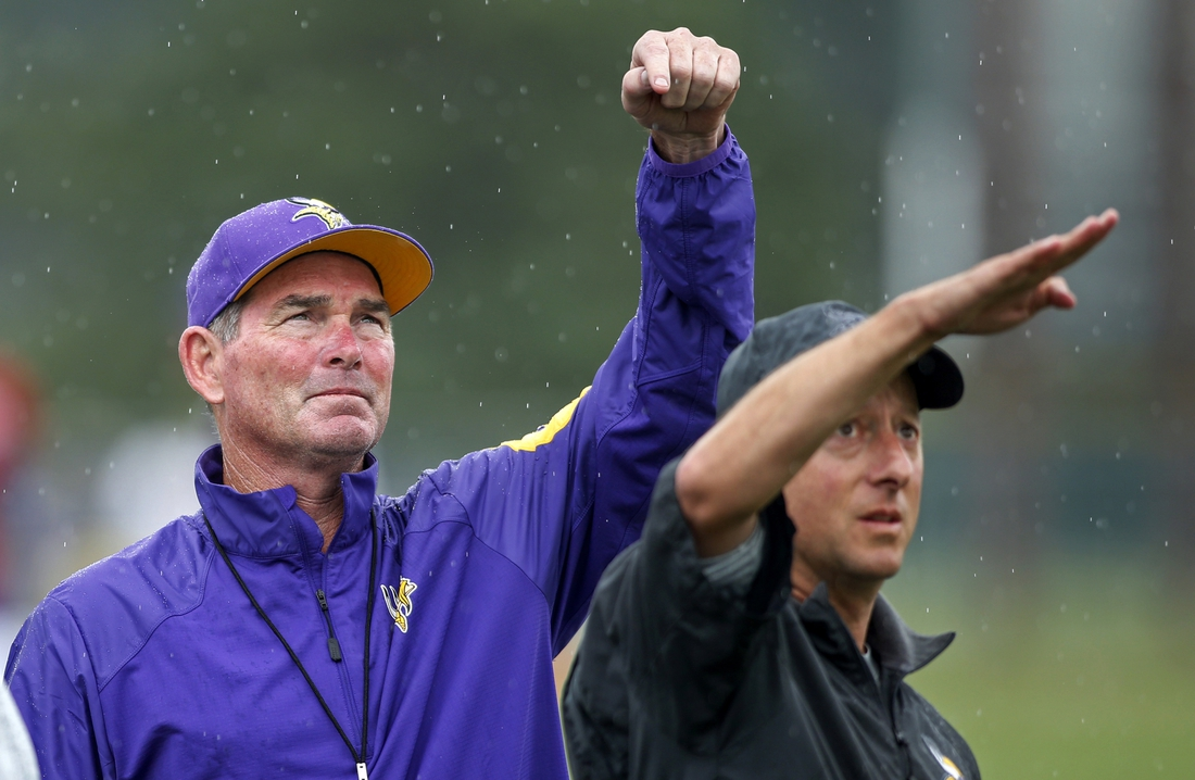 Aug 1, 2016; Mankato, MN, USA; Minnesota Vikings head coach Mike Zimmer (left) gestures with head athletic trainer Eric Sugarman (right) during a weather delay at training camp session at Minnesota State University. Mandatory Credit: Bruce Kluckhohn-USA TODAY Sports