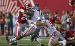 Aug 31, 2017; Bloomington, IN, USA; Indiana Hoosiers running back Mike Majette (24) rushes the ball and is tackled by Ohio State Buckeyes defensive lineman Haskell Garrett (92) and defensive lineman Jerron Cage (98) in the first quarter of the game at Memorial Stadium. Mandatory Credit: Trevor Ruszkowski-USA TODAY Sports