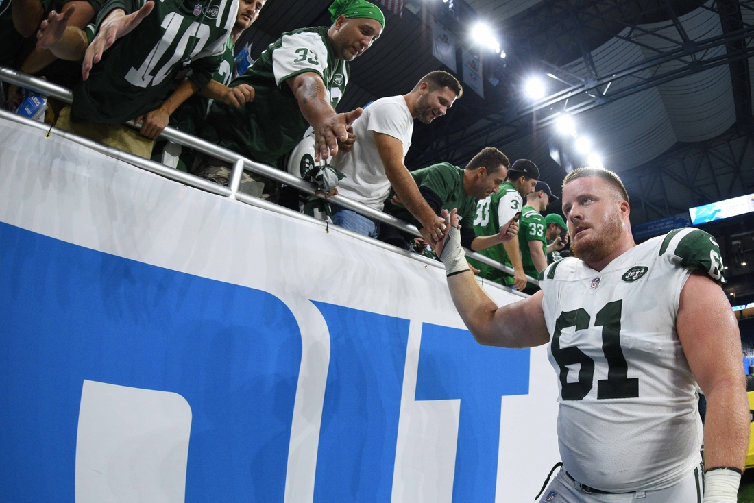 Sep 10, 2018; Detroit, MI, USA; New York Jets center Spencer Long (61) high fives fans after the game against the Detroit Lions at Ford Field. Mandatory Credit: Tim Fuller-USA TODAY Sports