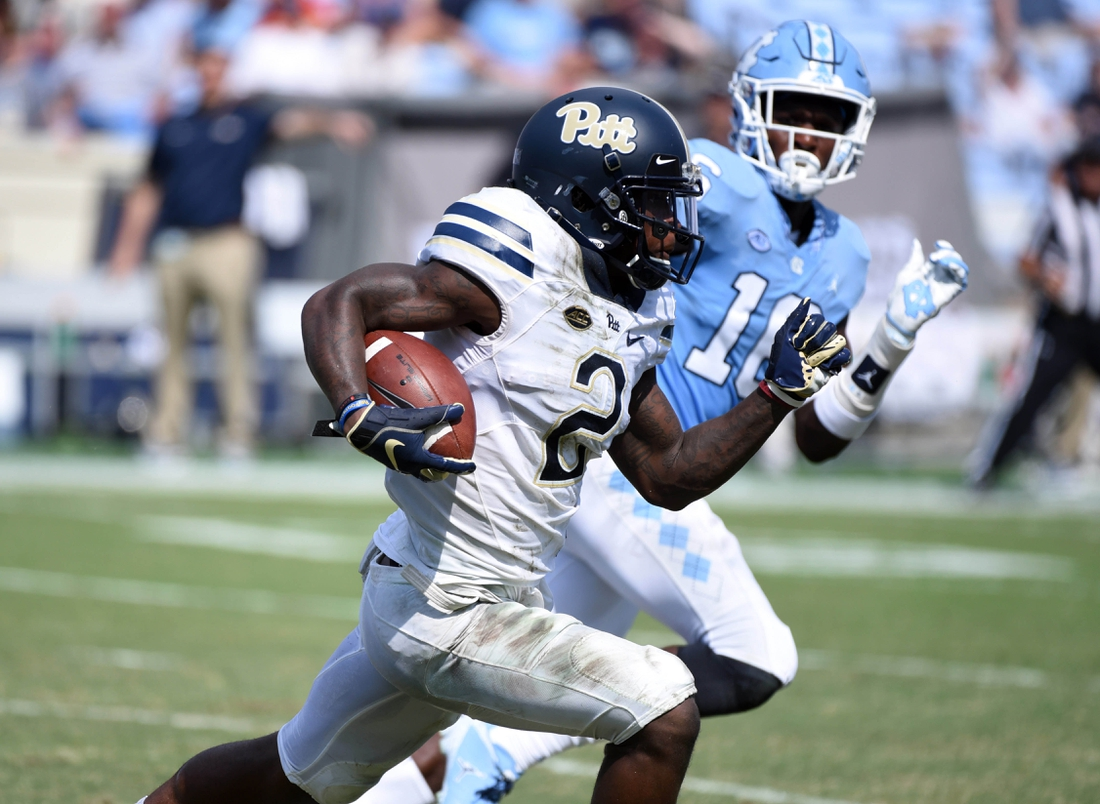 Sep 22, 2018; Chapel Hill, NC, USA; Pitt Panthers receiver Maurice Ffrench (2) runs the ball as North Carolina Tar Heels safety D.J. Ford defends during the second half at Kenan Memorial Stadium. The Tar Heels won  38-35. Mandatory Credit: Rob Kinnan-USA TODAY Sports