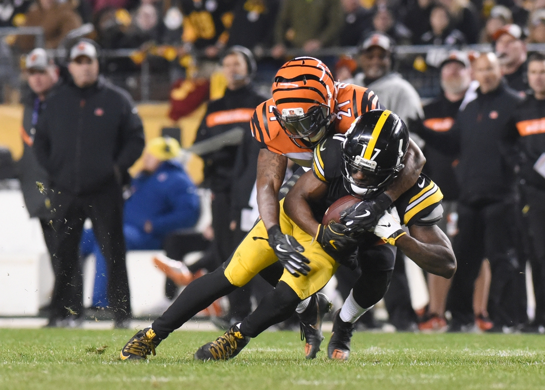 Dec 30, 2018; Pittsburgh, PA, USA; Pittsburgh Steelers wide receiver Eli Rogers (17) is tackled in the fourth quarter by Cincinnati Bengals cornerback Darqueze Dennard (21) at Heinz Field. Mandatory Credit: Philip G. Pavely-USA TODAY Sports
