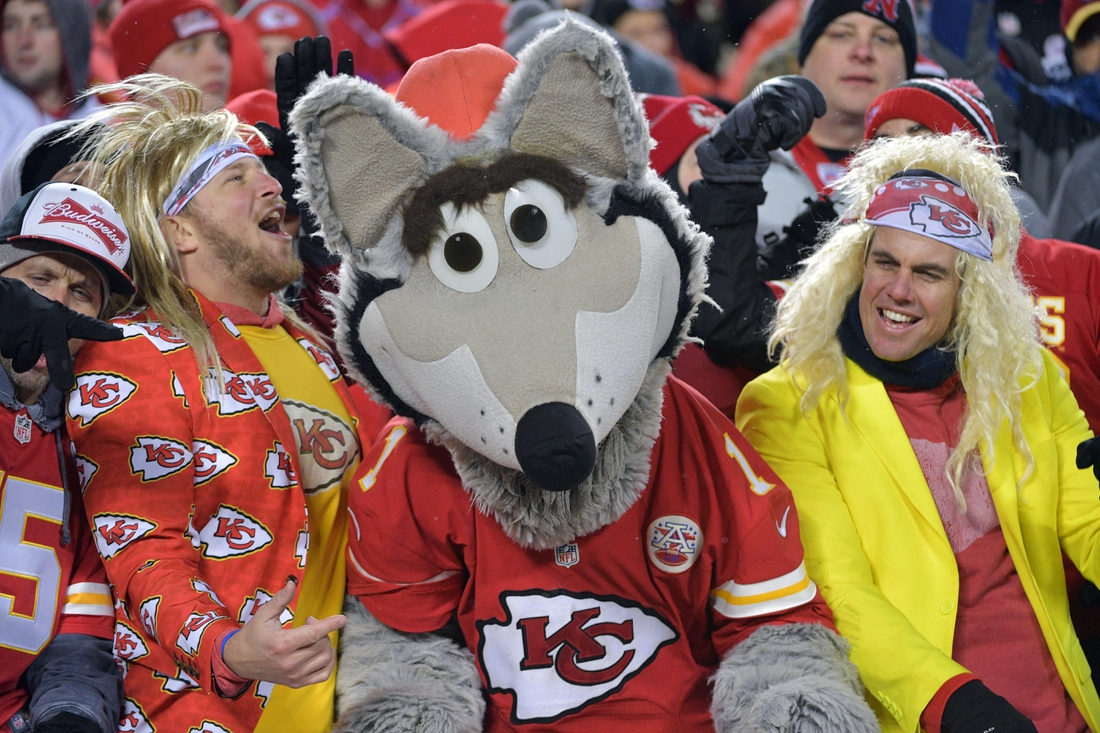 Jan 12, 2019; Kansas City, MO, USA; Fans dance with the Kansas City Chiefs mascot during the third quarter against the Indianapolis Colts in an AFC Divisional playoff football game at Arrowhead Stadium. Mandatory Credit: Denny Medley-USA TODAY Sports
