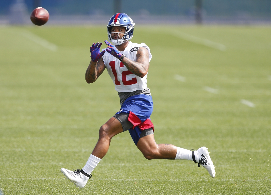 May 20, 2019; East Rutherford, NJ, USA; New York Giants wide receiver Cody Latimer (12) makes a catch during organized team activities at Quest Diagnostic Training Center. Mandatory Credit: Noah K. Murray-USA TODAY Sports