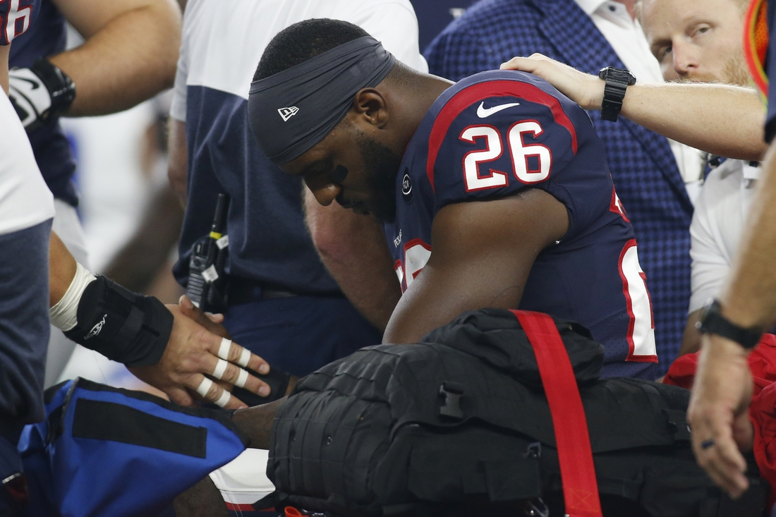 Aug 24, 2019; Arlington, TX, USA; Houston Texans running back Lamar Miller (26) is carted off the field after suffering an apparent injury in the first quarter against the Dallas Cowboys at AT&T Stadium. Mandatory Credit: Tim Heitman-USA TODAY Sports