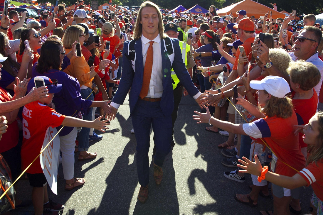 Aug 29, 2019; Clemson, SC, USA; Clemson Tigers quarterback Trevor Lawrence (16) greets fans during Tiger Walk prior to a game against the Georgia Tech Yellow Jackets at Clemson Memorial Stadium. Mandatory Credit: Joshua S. Kelly-USA TODAY Sports