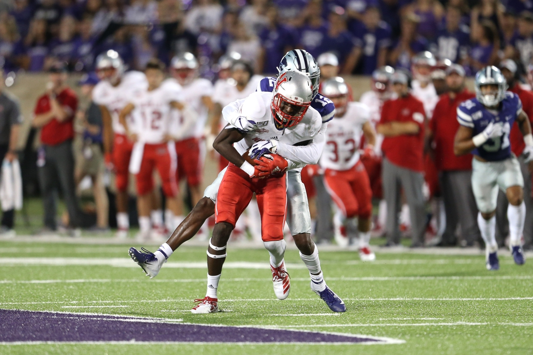 Aug 31, 2019; Manhattan, KS, USA; Nicholls State Colonels wide receiver Dai'Jean Dixon (5) is tackled by Kansas State Wildcats defensive back AJ Parker (12) during the fourth quarter at Bill Snyder Family Stadium. Mandatory Credit: Scott Sewell-USA TODAY Sports