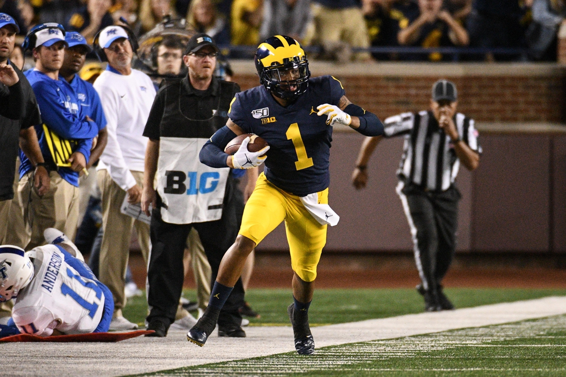 Aug 31, 2019; Ann Arbor, MI, USA; Michigan Wolverines defensive back Ambry Thomas (1) runs an interception back during the game against the Middle Tennessee Blue Raiders at Michigan Stadium. Mandatory Credit: Tim Fuller-USA TODAY Sports