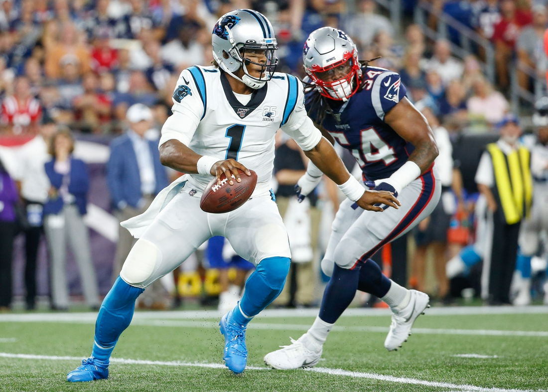 Aug 22, 2019; Foxborough, MA, USA; Carolina Panthers quarterback Cam Newton (1) is forced out of the pocket by New England Patriots outside linebacker Dont'a Hightower (54) during the first half at Gillette Stadium. Mandatory Credit: Greg M. Cooper-USA TODAY Sports