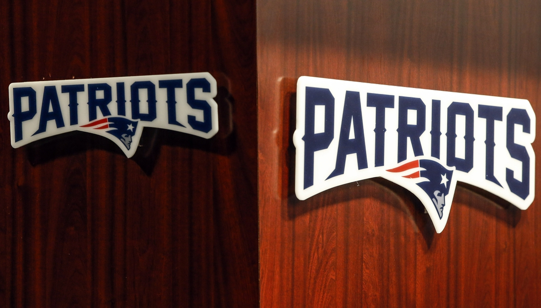 Sep 11, 2019; Foxborough, MA, USA; New England Patriot logos on the podium during the press conference before practice at Gillette Stadium. Mandatory Credit: Greg M. Cooper-USA TODAY Sports
