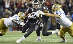 Sep 21, 2019; Pullman, WA, USA; Washington State Cougars safety Skyler Thomas (25) is tackled after an interception by UCLA Bruins offensive lineman Christaphany Murray (76) and offensive lineman Jake Burton (73) in the first half at Martin Stadium. Mandatory Credit: James Snook-USA TODAY Sports