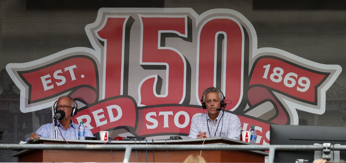 Sep 25, 2019; Cincinnati, OH, USA; Cincinnati Reds radio announcer Marty Brennaman (left) and his son Thom Brennaman (right) broadcast from a temporary radio booth in the seating bowl at the beginning of a game between the Milwaukee Brewers an the Cincinnati Reds at Great American Ball Park. Mandatory Credit: David Kohl-USA TODAY Sports