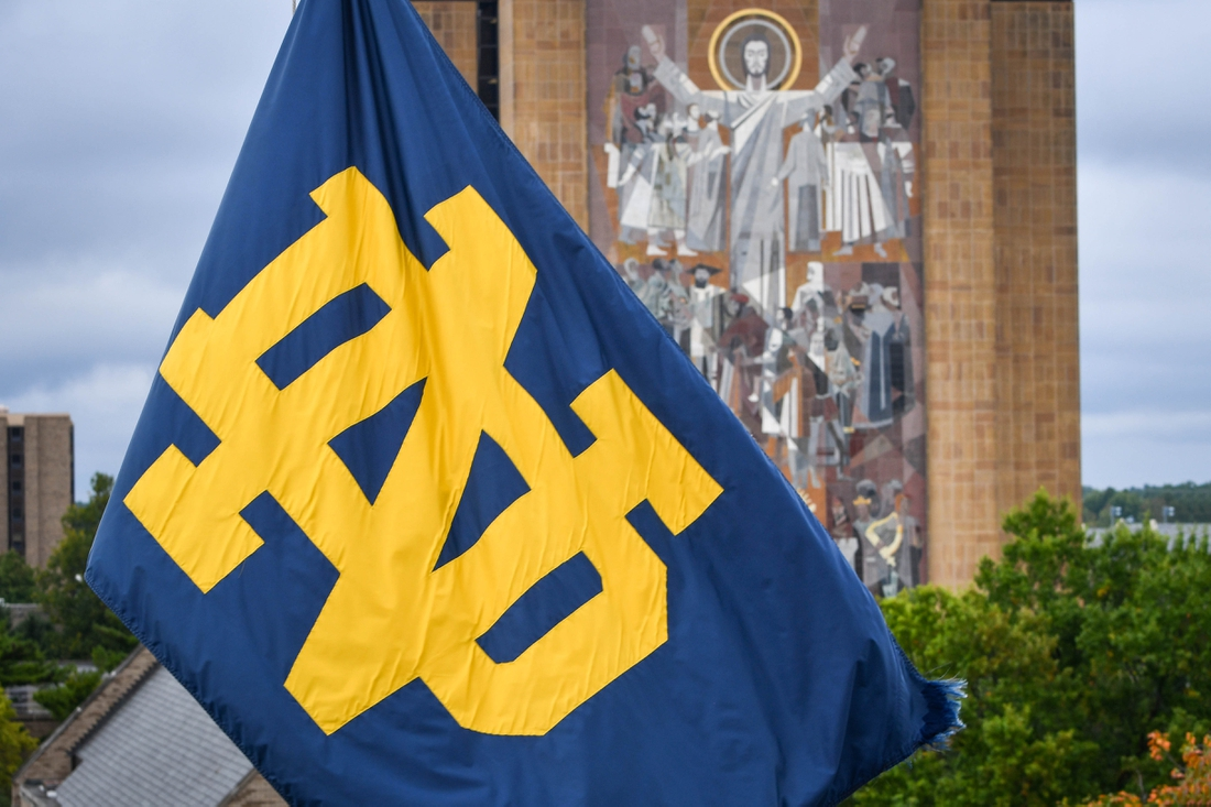 Sep 28, 2019; South Bend, IN, USA; A Notre Dame monogram flag waves in front of the Word of Life mural, commonly known as Touchdown Jesus, on the campus of the University of Notre Dame before the game between the Notre Dame Fighting Irish and the Virginia Cavaliers at Notre Dame Stadium. Mandatory Credit: Matt Cashore-USA TODAY Sports