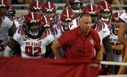 Sep 28, 2019; Tallahassee, FL, USA; North Carolina State Wolfpack head coach Dave Doeren with his team before the start of the game against the Florida State Seminoles at Doak Campbell Stadium. Mandatory Credit: Melina Myers-USA TODAY Sports