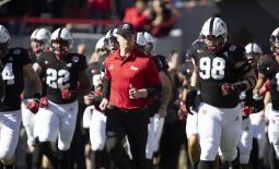 Oct 26, 2019; Lincoln, NE, USA; Nebraska Cornhuskers head coach Scott Frost leads his team onto the field against the Indiana Hoosiers in the first half at Memorial Stadium. Mandatory Credit: Bruce Thorson-USA TODAY Sports