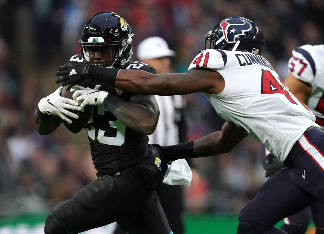 Nov 3, 2019; London, United Kingdom; Jacksonville Jaguars running back Ryquell Armstead (23) is defended by Houston Texans inside linebacker Zach Cunningham (41) in the second half during an NFL International Series game at Wembley Stadium.  The Texans defeated the Jaguars 26-3. Mandatory Credit: Kirby Lee-USA TODAY Sports