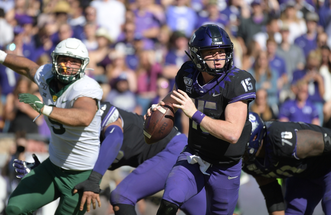 Nov 9, 2019; Fort Worth, TX, USA; TCU Horned Frogs quarterback Max Duggan (15) throws the ball against the Baylor Bears in the third quarter at Amon G. Carter Stadium. Baylor won 29-23 in triple overtime.  Mandatory Credit: Kirby Lee-USA TODAY Sports