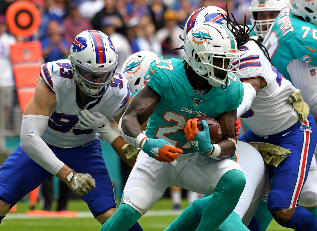 Nov 17, 2019; Miami Gardens, FL, USA; Miami Dolphins running back Kalen Ballage (27) is tackled by Buffalo Bills defensive end Trent Murphy (93) during the first half at Hard Rock Stadium. Mandatory Credit: Steve Mitchell-USA TODAY Sports