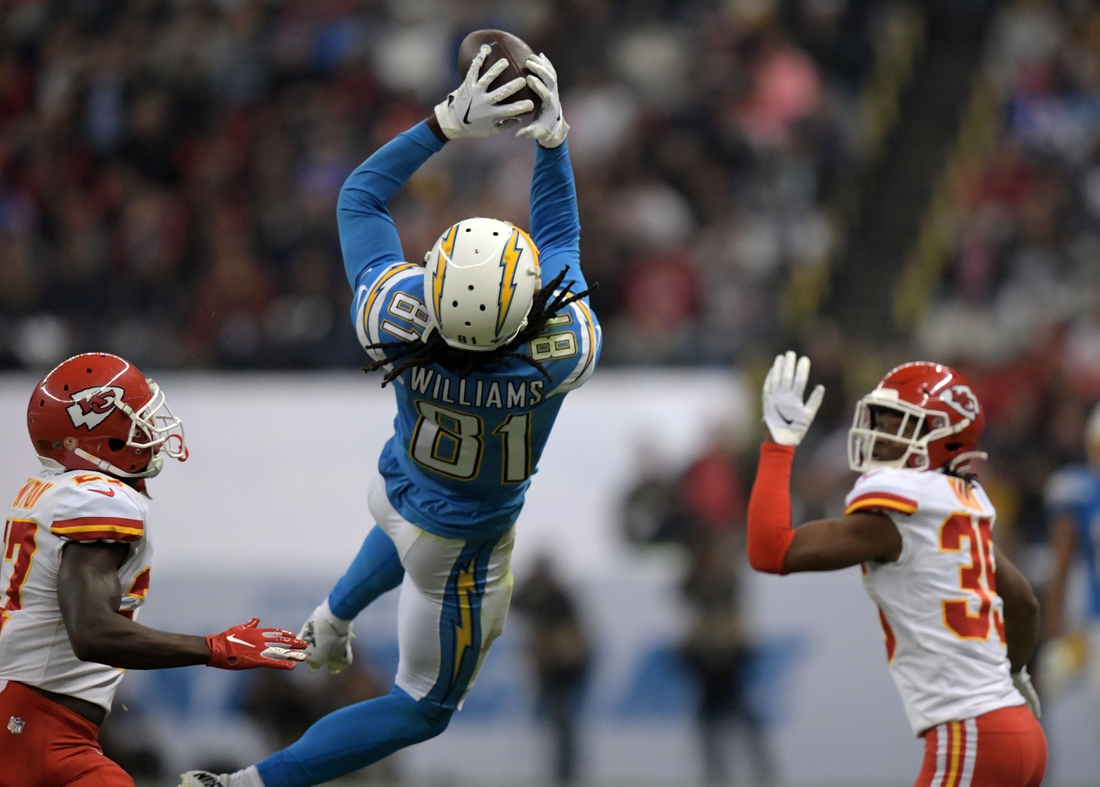 Nov 18, 2019; Mexico City, MEX; Los Angeles Chargers wide receiver Mike Williams (81) makes a 50-yard reception in the fourth quarter as Kansas City Chiefs defensive back Rashad Fenton (27) and cornerback Charvarius Ward (35) defend during an NFL International Series game at Estadio Azteca. The Chiefs defeated the Chargers 24-17. Mandatory Credit: Kirby Lee-USA TODAY Sports