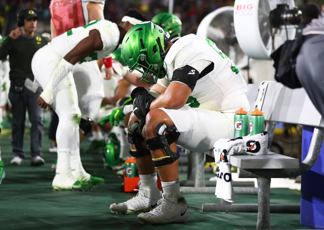 Nov 23, 2019; Tempe, AZ, USA; Oregon Ducks offensive lineman Penei Sewell reacts on the bench in the closing minute of the game against the Arizona State Sun Devils at Sun Devil Stadium. Mandatory Credit: Mark J. Rebilas-USA TODAY Sports