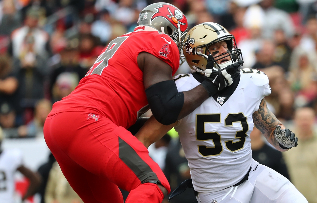 Nov 17, 2019; Tampa, FL, USA;Tampa Bay Buccaneers offensive tackle Demar Dotson (69) blocks New Orleans Saints outside linebacker A.J. Klein (53) during the first half at Raymond James Stadium. Mandatory Credit: Kim Klement-USA TODAY Sports