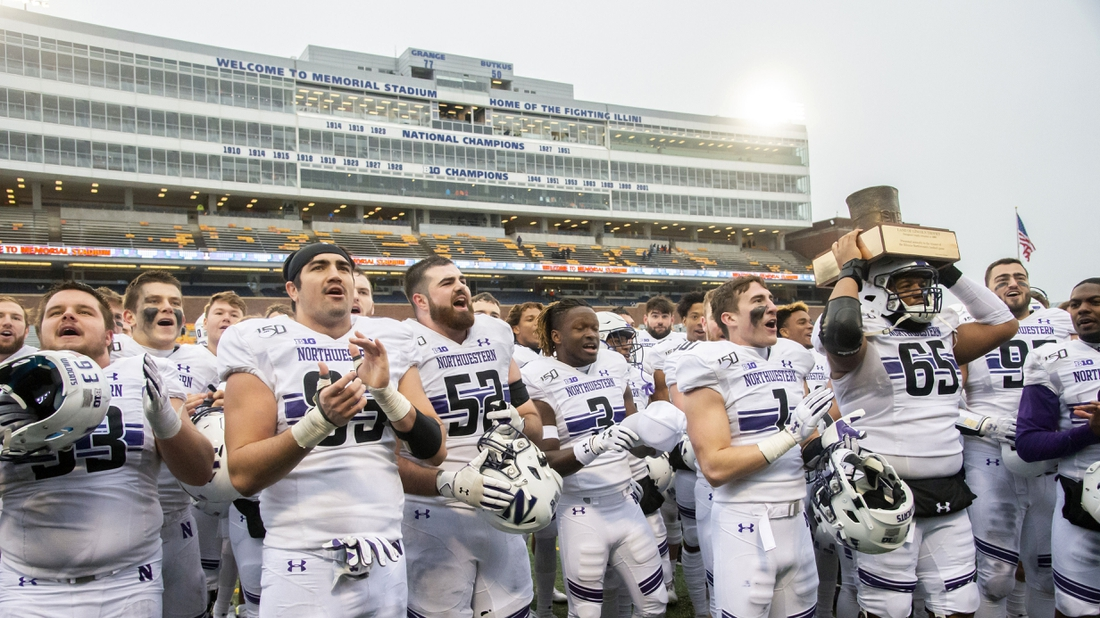 Nov 30, 2019; Champaign, IL, USA; The Northwestern Wildcats celebrate with the Land of Lincoln Trophy after defeating the Illinois Fighting Illini at Memorial Stadium. Mandatory Credit: Patrick Gorski-USA TODAY Sports