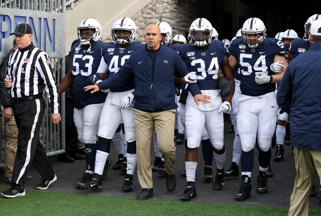 Nov 30, 2019; University Park, PA, USA; Penn State Nittany Lions head coach James Franklin leads his team out of the tunnel prior to taking the field against the Rutgers Scarlet Knights at Beaver Stadium. Mandatory Credit: Matthew O'Haren-USA TODAY Sports