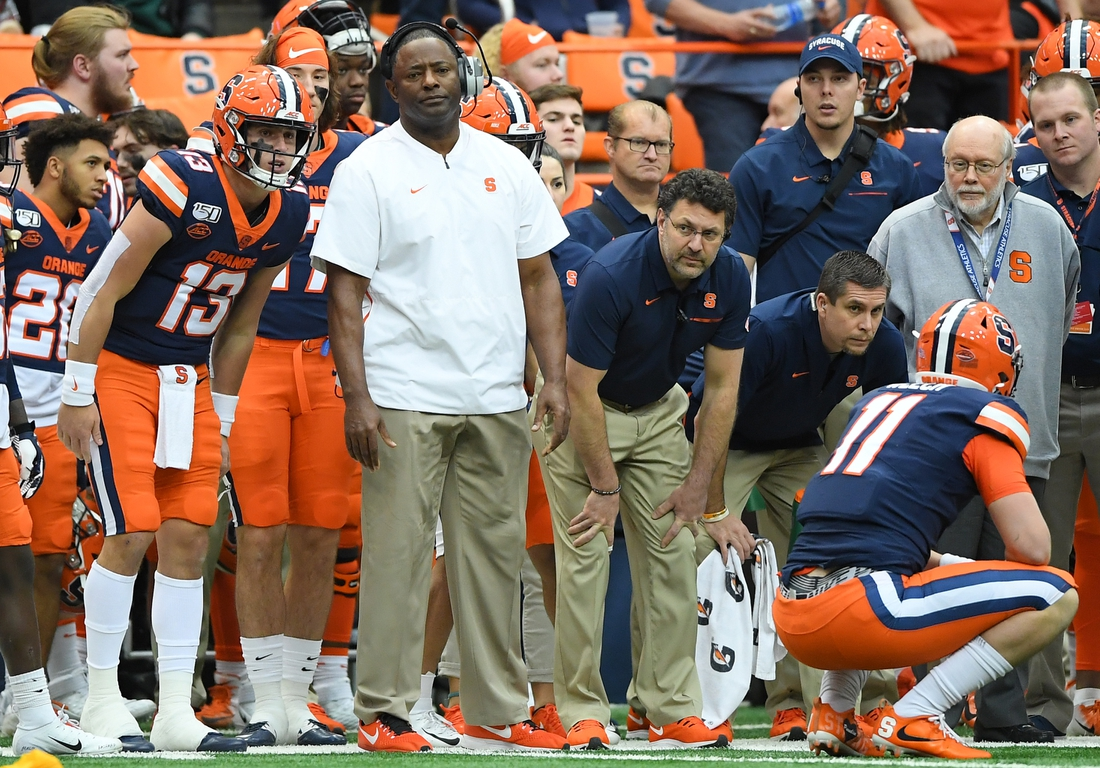 Nov 30, 2019; Syracuse, NY, USA; Syracuse Orange head coach Dino Babers looks on with quarterback Tommy DeVito (13) from the sidelines at injured quarterback Clayton Welch (11) against the Wake Forest Demon Deacons during the third quarter at the Carrier Dome. Mandatory Credit: Rich Barnes-USA TODAY Sports