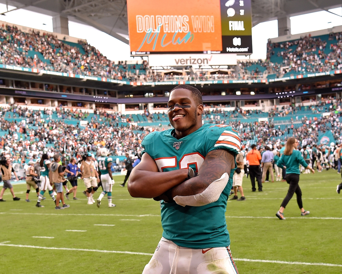 Dec 1, 2019; Miami Gardens, FL, USA; Miami Dolphins middle linebacker Raekwon McMillan (52) reacts after defeating the Philadelphia Eagles at Hard Rock Stadium. Mandatory Credit: Steve Mitchell-USA TODAY Sports