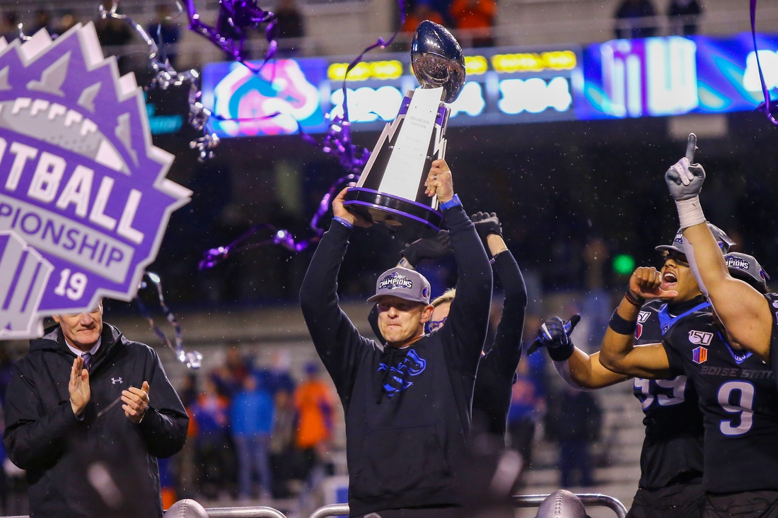 Dec 7, 2019; Boise, ID, USA; Boise State Broncos head coach Bryan Harsin hoist the trophy after defeating the Hawaii Warriors in the Mountain West Championship at Albertsons  Stadium.  Boise State defeats Hawaii 31-10.  Mandatory Credit: Brian Losness-USA TODAY Sports