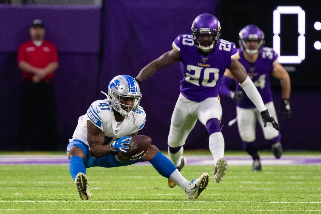 Dec 8, 2019; Minneapolis, MN, USA; Detroit Lions running back J.D. McKissic (41) catches a pass in the fourth quarter against Minnesota Vikings defensive back Mackensie Alexander (20) at U.S. Bank Stadium. Mandatory Credit: Brad Rempel-USA TODAY Sports