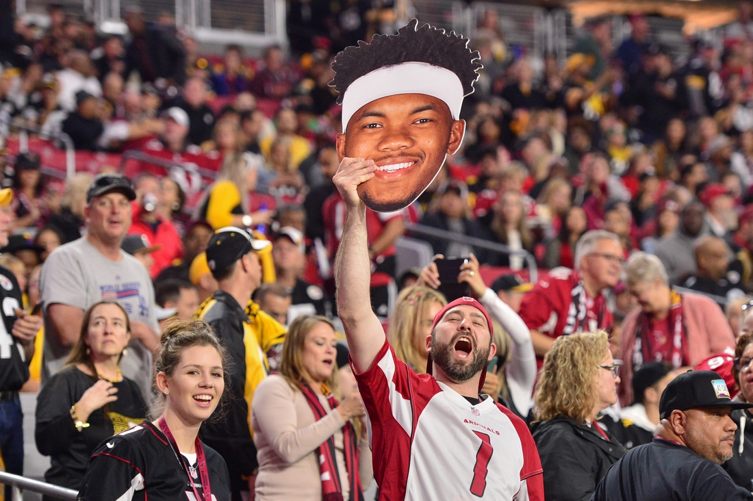 Dec 8, 2019; Glendale, AZ, USA; A fan holds a Arizona Cardinals quarterback Kyler Murray (1) sign prior to the game against the Pittsburgh Steelers at State Farm Stadium. Mandatory Credit: Matt Kartozian-USA TODAY Sports
