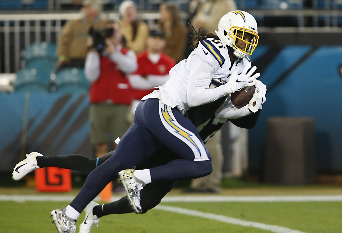 Dec 8, 2019; Jacksonville, FL, USA; Los Angeles Chargers wide receiver Mike Williams (81) makes a touchdown catch while being covered by Jacksonville Jaguars cornerback Tre Herndon (37) during the second half at TIAA Bank Field. Mandatory Credit: Reinhold Matay-USA TODAY Sports