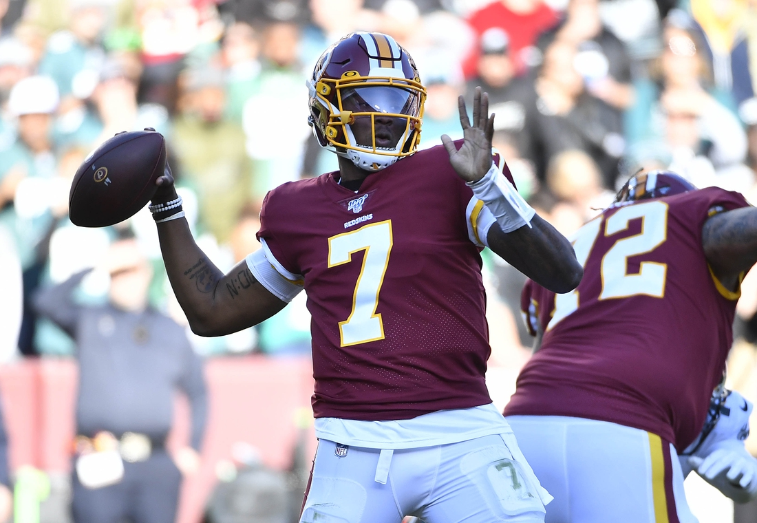 Dec 15, 2019; Landover, MD, USA; Washington Redskins quarterback Dwayne Haskins (7) attempts a pass against the Philadelphia Eagles during the first half at FedExField. Mandatory Credit: Brad Mills-USA TODAY Sports