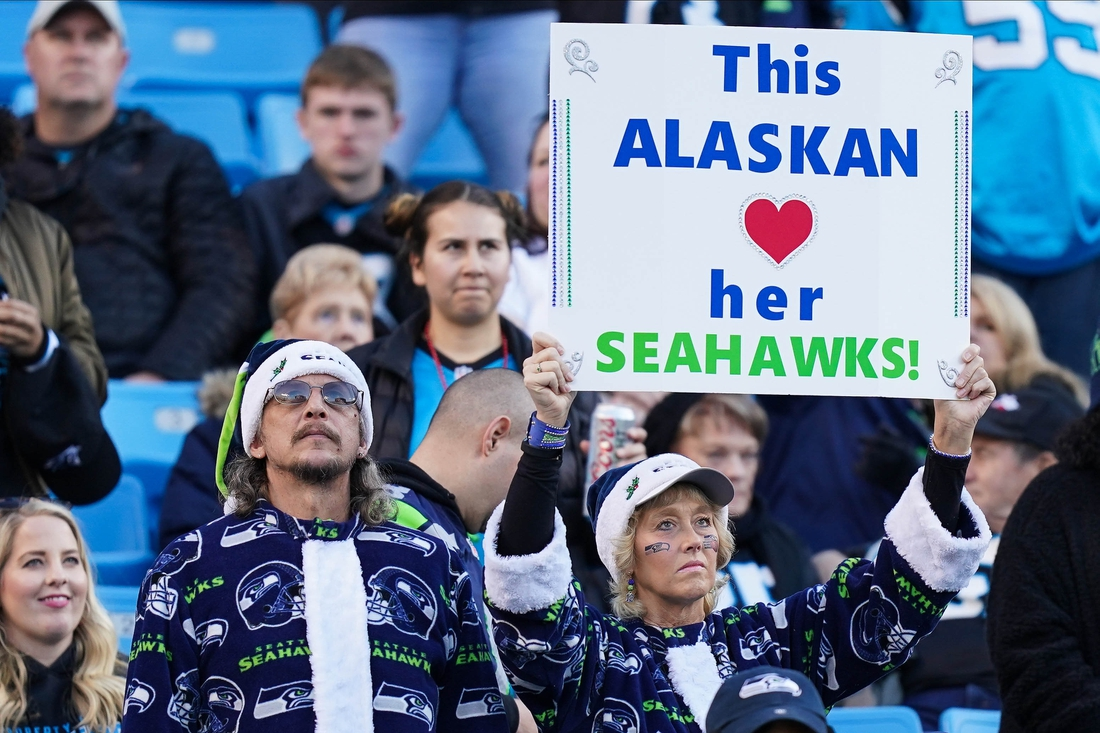 Dec 15, 2019; Charlotte, NC, USA; Seattle Seahawks fans show their sign during the second half against the Carolina Panthers at Bank of America Stadium. Mandatory Credit: Jim Dedmon-USA TODAY Sports