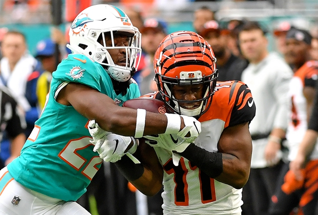 Dec 22, 2019; Miami Gardens, Florida, USA; Cincinnati Bengals wide receiver John Ross (11) makes a catch in front of Miami Dolphins defensive back Tae Hayes (22) during the first half at Hard Rock Stadium. Mandatory Credit: Steve Mitchell-USA TODAY Sports