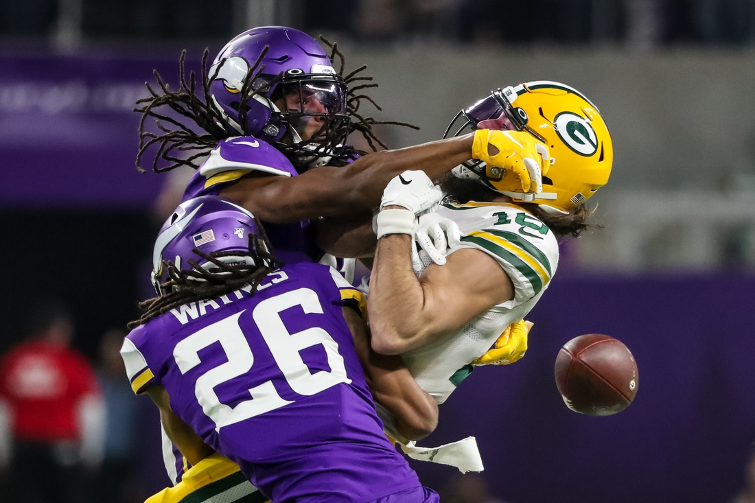 Dec 23, 2019; Minneapolis, Minnesota, USA; Minnesota Vikings cornerback Anthony Harris (41) and cornerback Trae Waynes (26) break up a pass intended for Green Bay Packers wide receiver Jake Kumerow (16) during the third quarter at U.S. Bank Stadium. Mandatory Credit: Brace Hemmelgarn-USA TODAY Sports